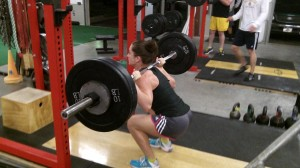 Female Athlete Training Squats at FITT Warehouse Gym Newnan Georgia
